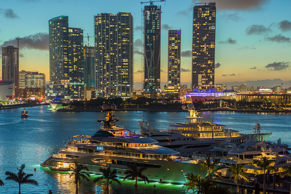 Miami Marina with 2 large boats with a backdrop of Miami Downtown buildings in the background