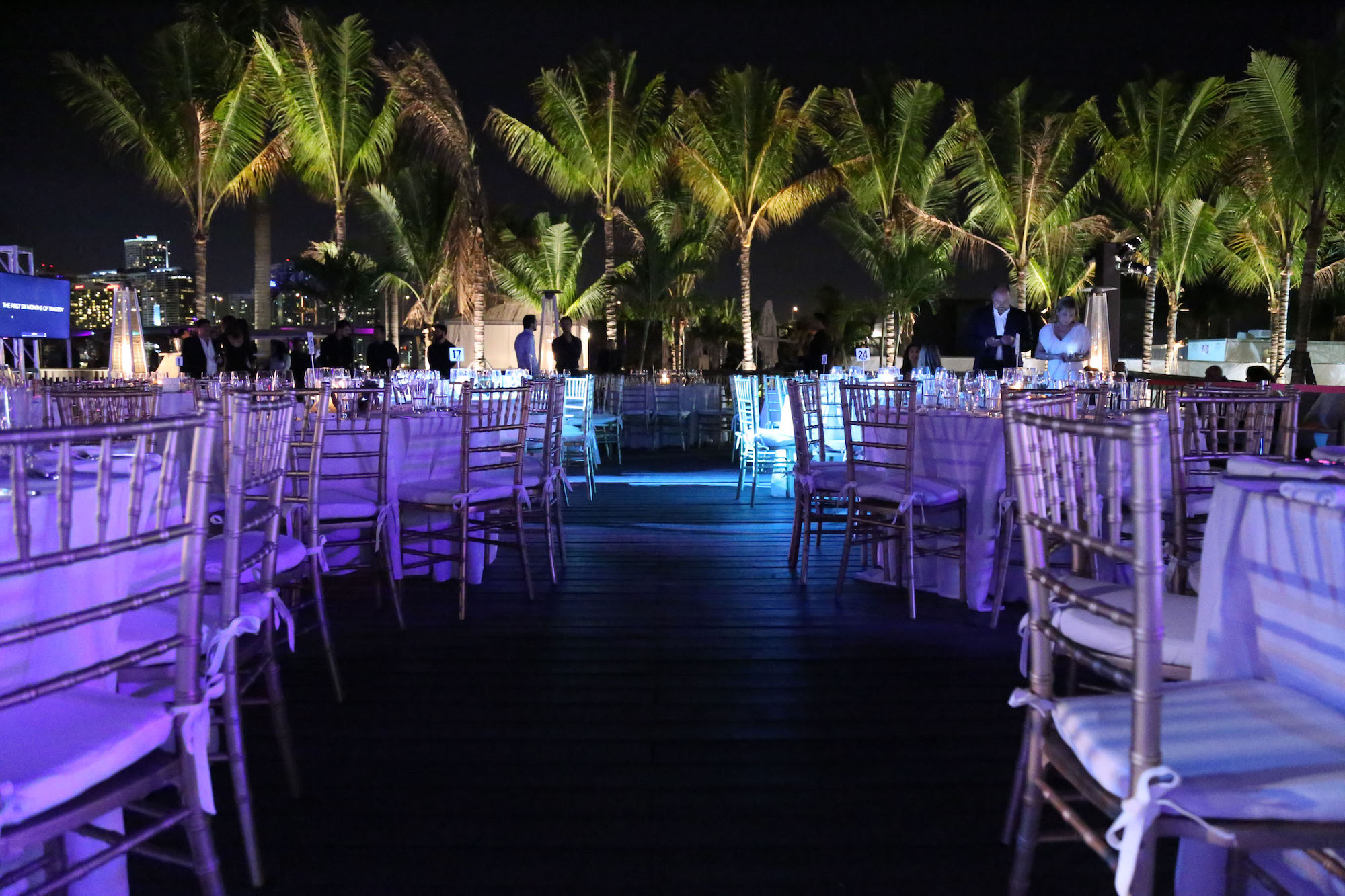 night photo of trees and tables for event space