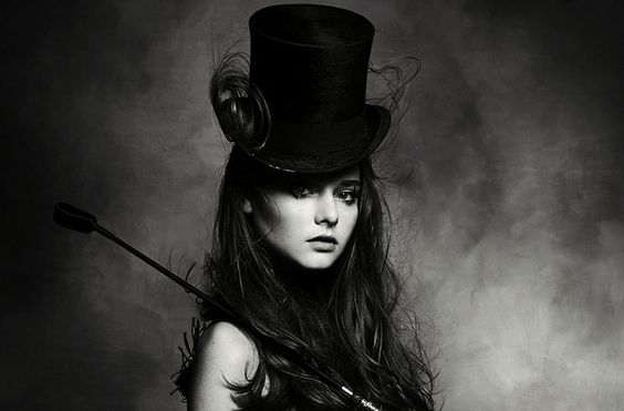 young woman with top hat on